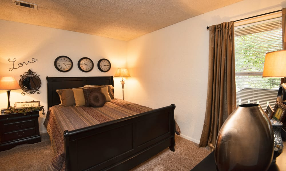 Carpeted bedroom at Aspen Park Apartments in Wichita, Kansas