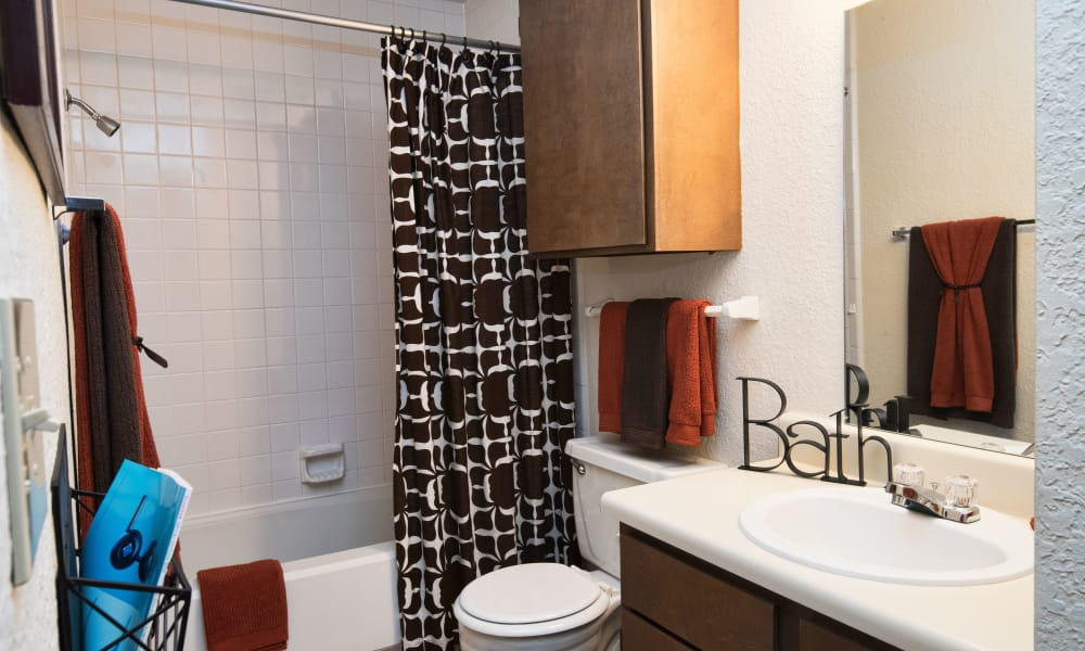 A well-lit bathroom at Aspen Park Apartments in Wichita, Kansas