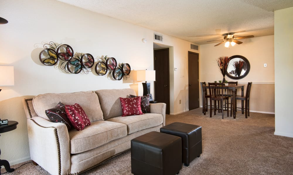 Carpeted living room at Aspen Park Apartments in Wichita, Kansas
