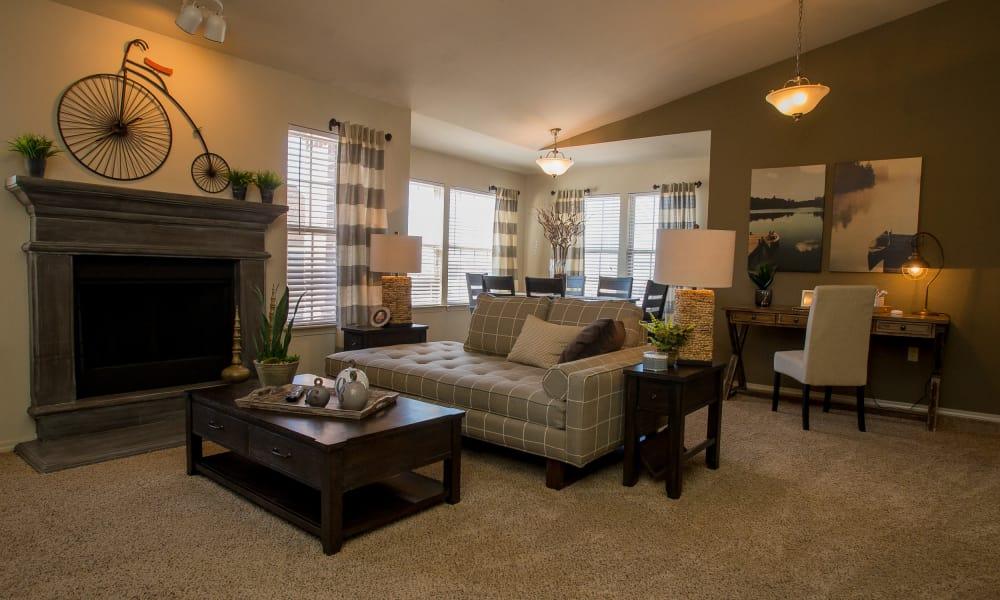 Carpeted living room at Villas at Canyon Ranch in Yukon, Oklahoma