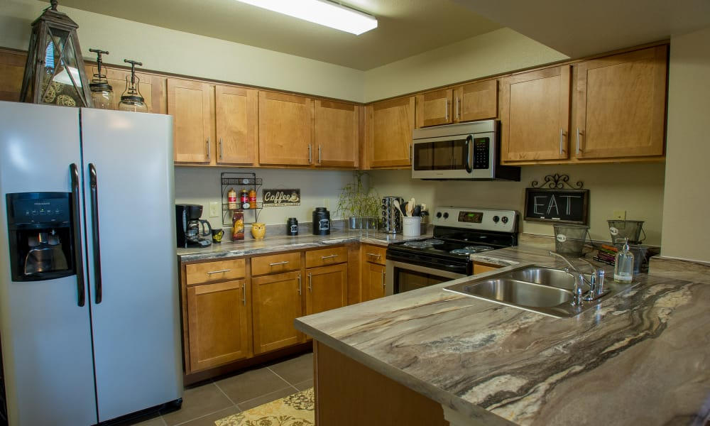 Kitchen with plenty of cabinet space at Cascata Apartments in Tulsa, Oklahoma