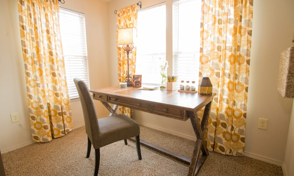 Desk by a window at Cascata Apartments in Tulsa, Oklahoma
