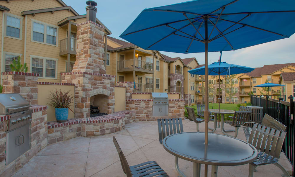 A patio area with fireplace at Cascata Apartments in Tulsa, Oklahoma