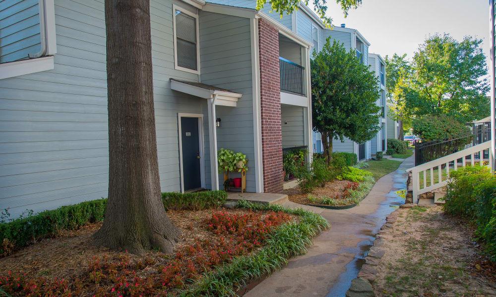 Pathway between apartments at Cedar Glade Apartments in Tulsa, Oklahoma
