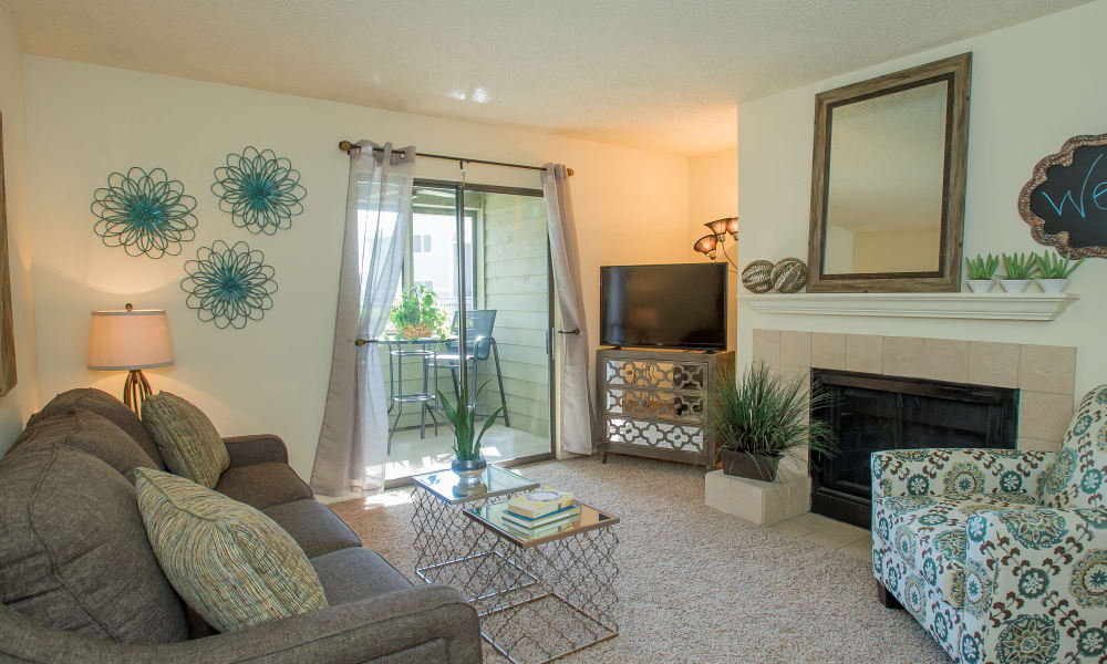 Living room with a fireplace at Sugarberry Apartments in Tulsa, Oklahoma
