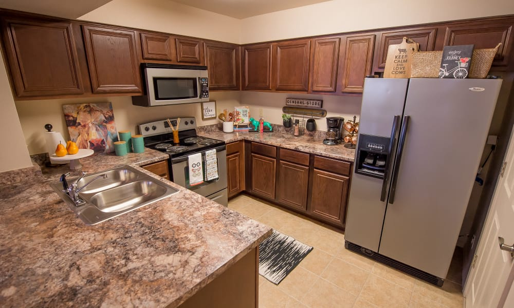 Kitchen with plenty of cabinet space at The Park on Westpointe in Yukon, Oklahoma