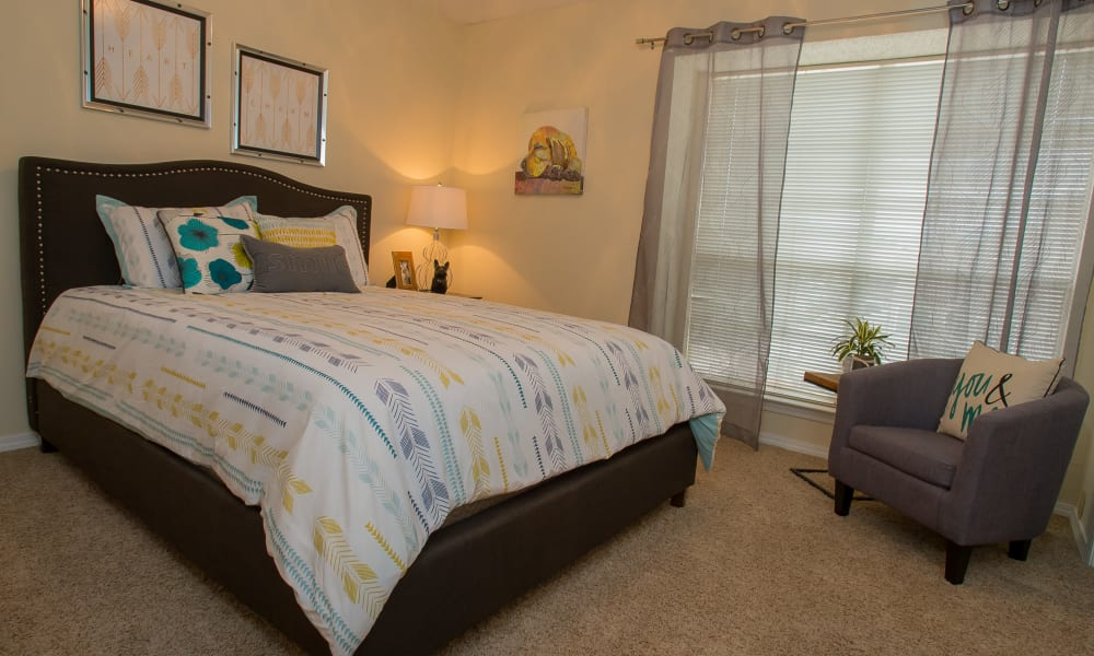 Spacious bedroom with a view at Creekwood Apartments in Tulsa, Oklahoma
