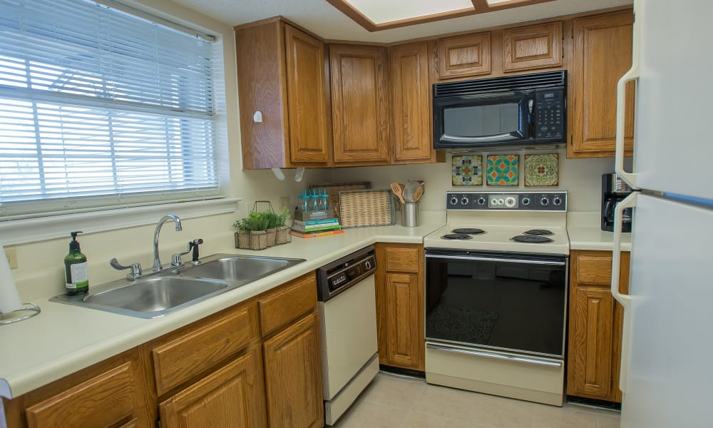 Kitchen with plenty of cabinet space at Creekwood Apartments in Tulsa, Oklahoma