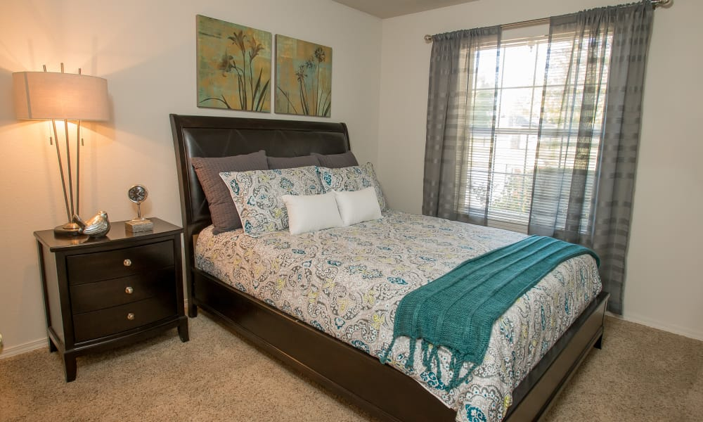 Spacious bedroom with a view at Crown Pointe Apartments in Oklahoma City, Oklahoma