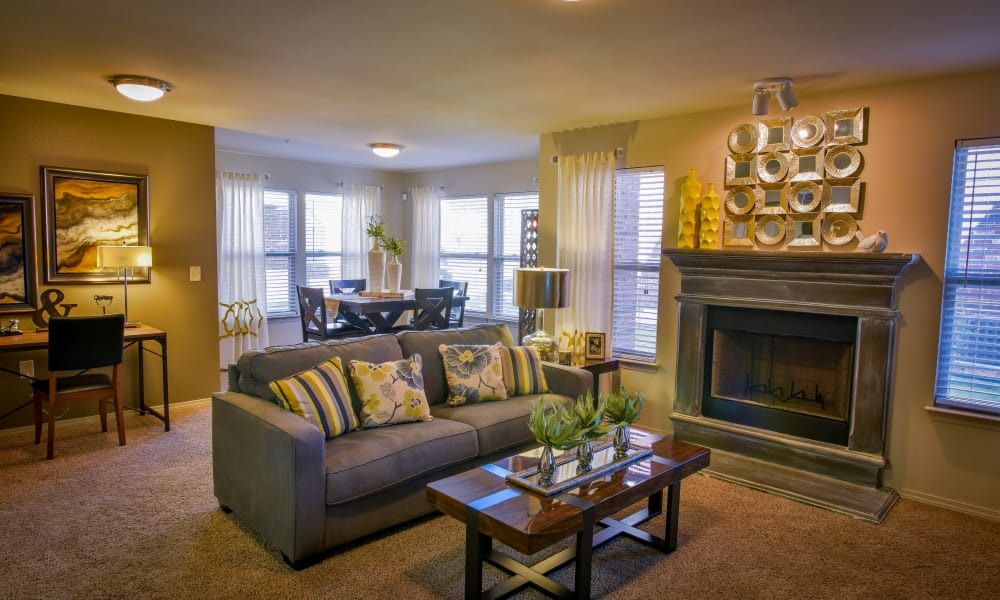 Carpeted living room with a fireplace at The Icon at Lubbock in Lubbock, Texas