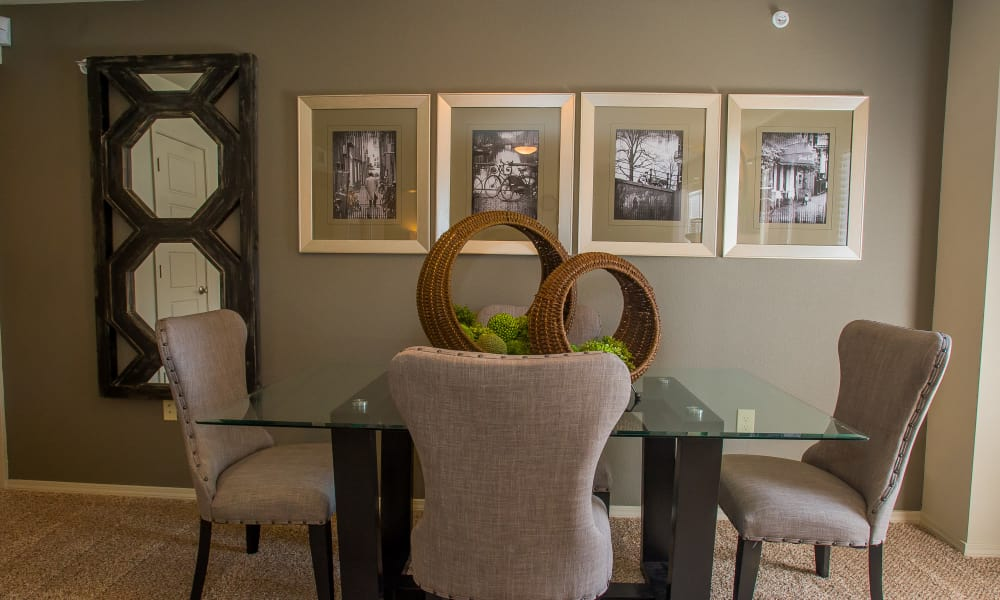 A well decorated dining room table at Icon at Broken Arrow in Broken Arrow, Oklahoma
