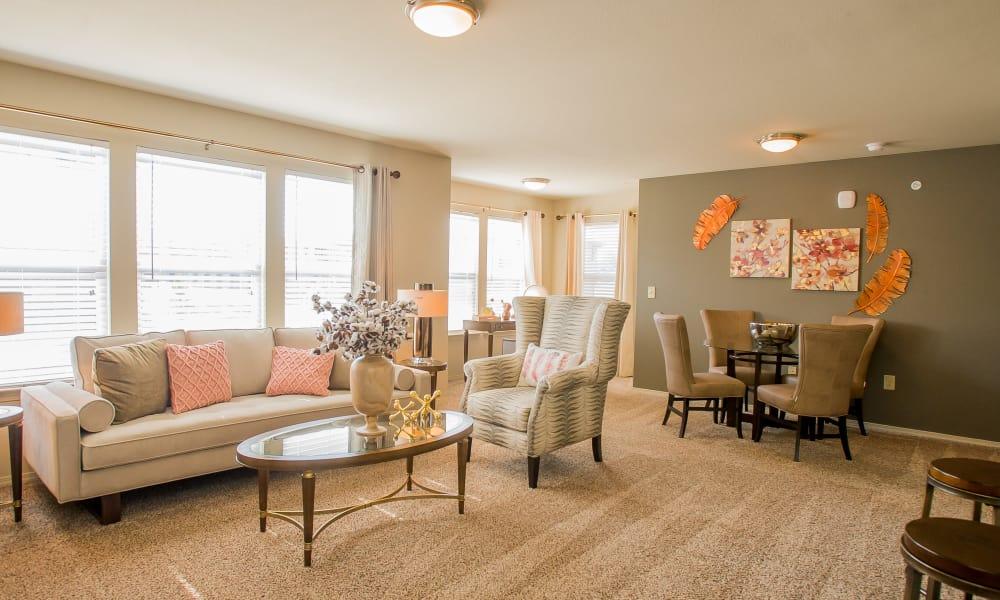Icon at Broken Arrow offers a spacious living room in Broken Arrow, Oklahoma