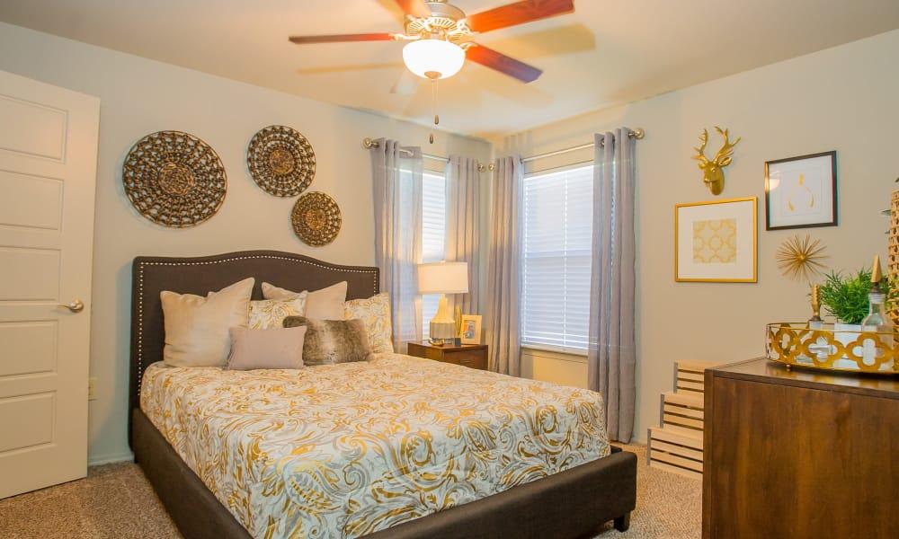 A well decorated bedroom at Icon at Broken Arrow in Broken Arrow, Oklahoma