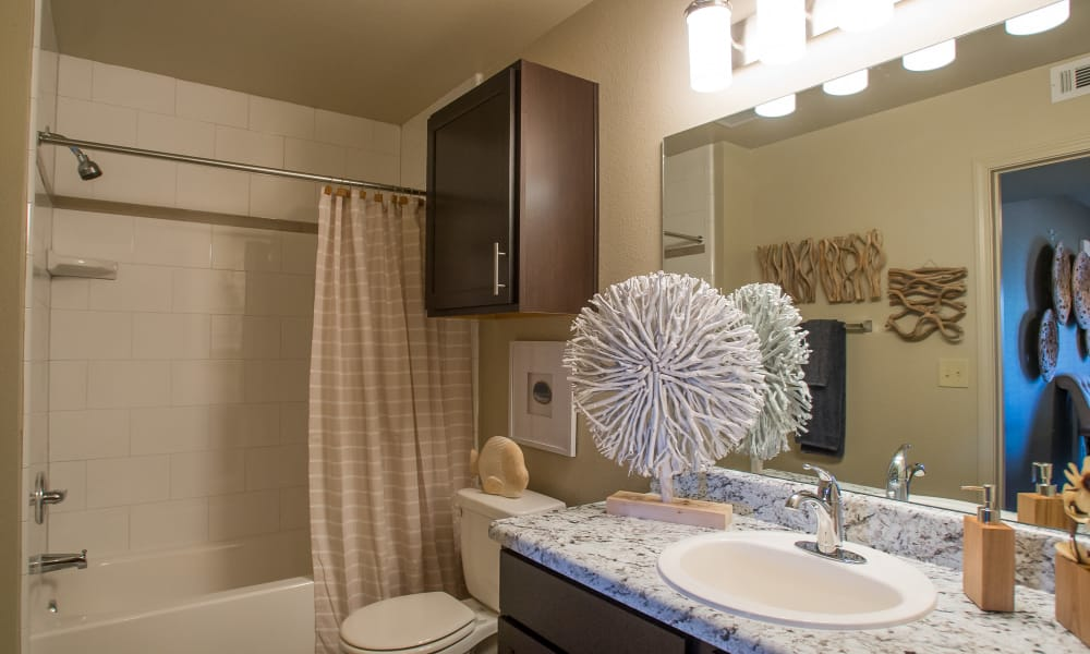Large bathroom with plenty of counter space at Icon at Broken Arrow in Broken Arrow, Oklahoma