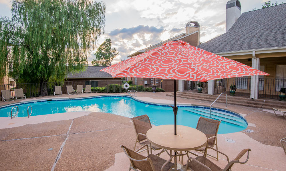 Swimming pool and seating area at Windsail Apartments in Tulsa, Oklahoma