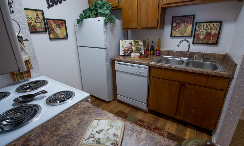 Model kitchen with white appliances at Windsail Apartments in Tulsa, Oklahoma