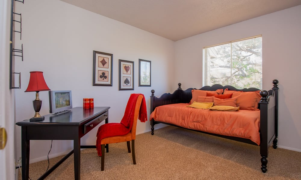 Daybed and desk in spacious room at Windsail Apartments in Tulsa, Oklahoma