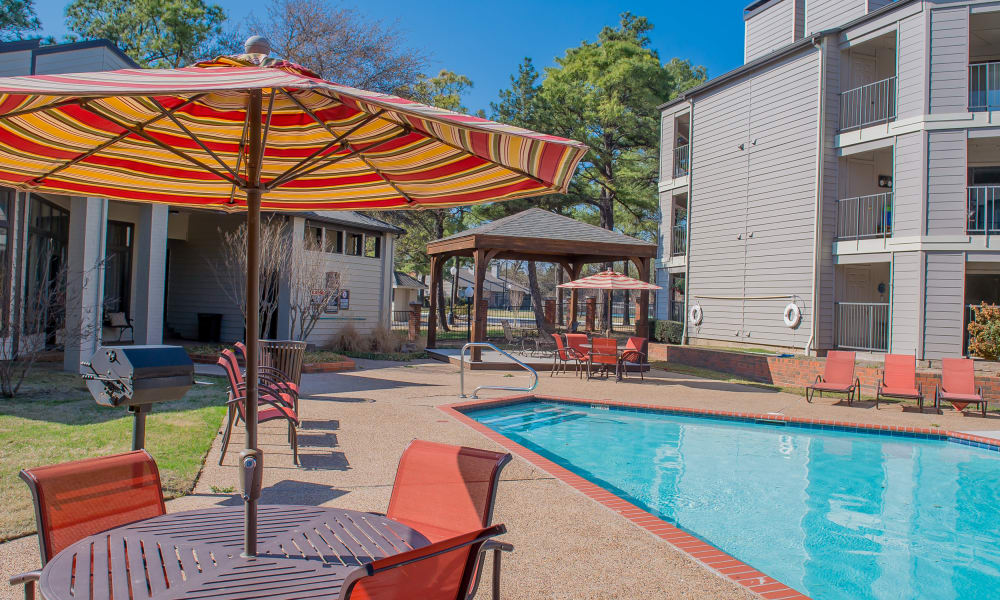 Poolside seating at Woodscape Apartments in Oklahoma City, Oklahoma