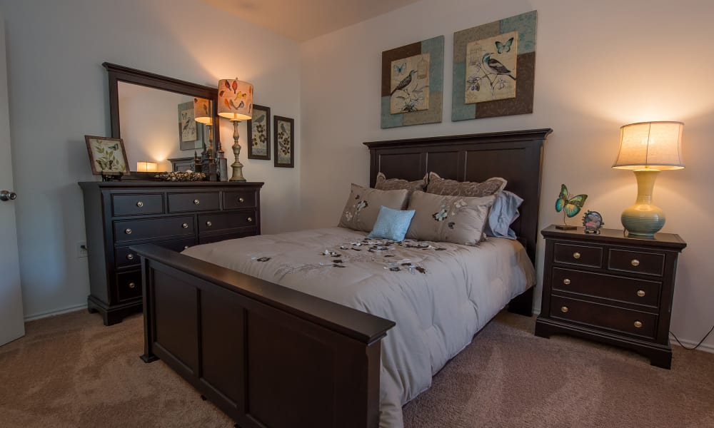 Cozy bedroom at The Pointe of Ridgeland in Ridgeland, Mississippi