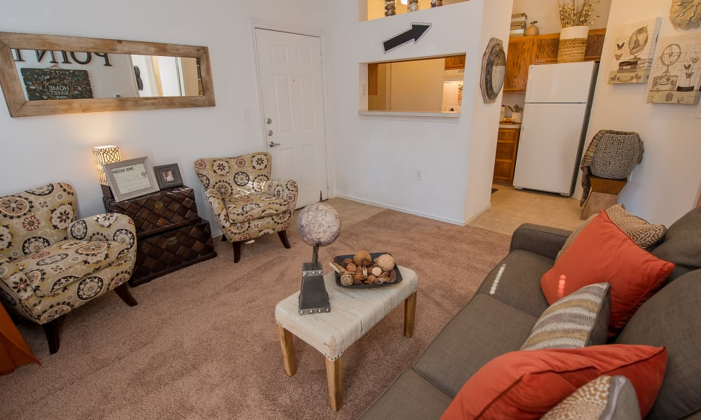 An apartment living room at The Pointe of Ridgeland in Ridgeland, MS