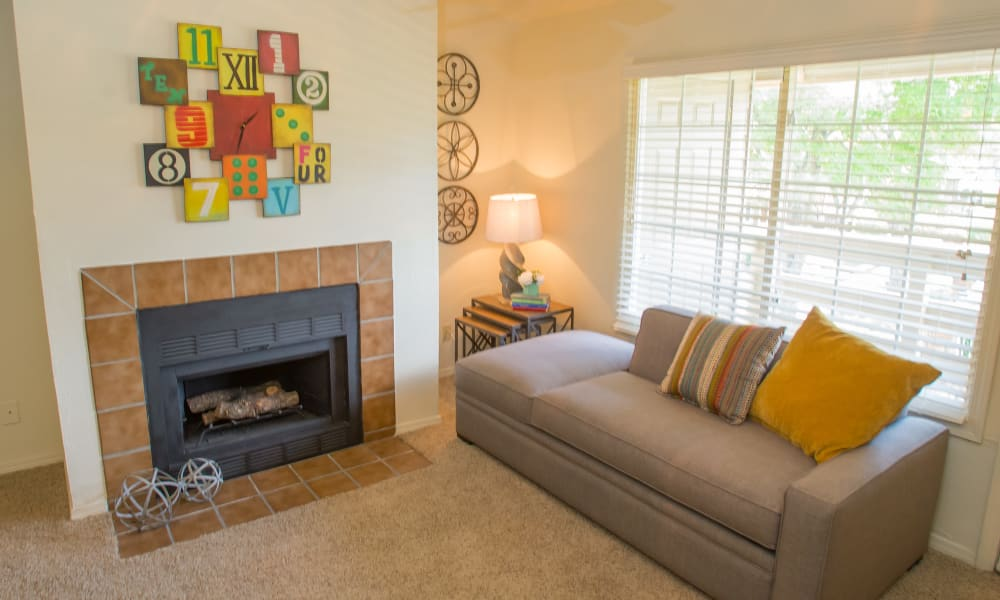 An apartment living room with fireplace at Chardonnay in Tulsa, OK