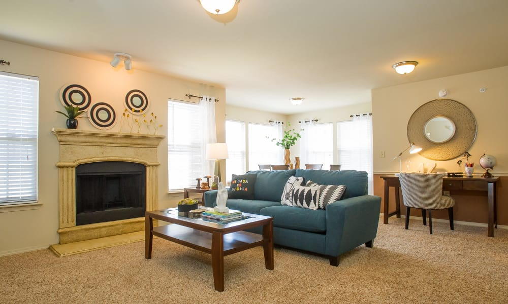 Carpeted living room with a fireplace at Tuscany Hills at Nickel Creek in Tulsa, Oklahoma