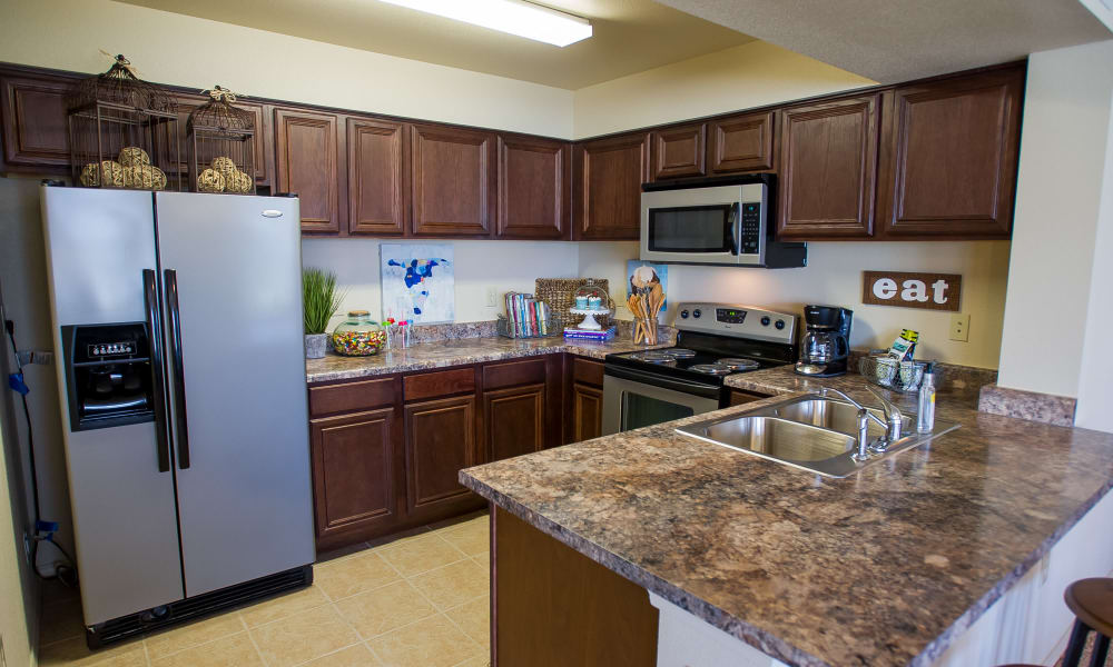 Kitchen with stainless steel appliances at Tuscany Hills at Nickel Creek in Tulsa, Oklahoma