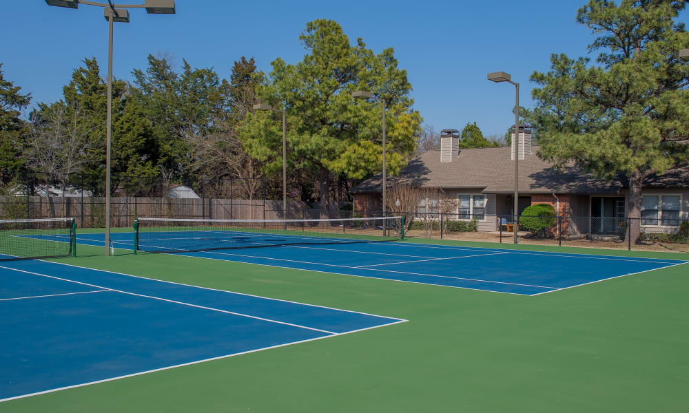 Two tennis courts at Woodscape Apartments in Oklahoma City, Oklahoma