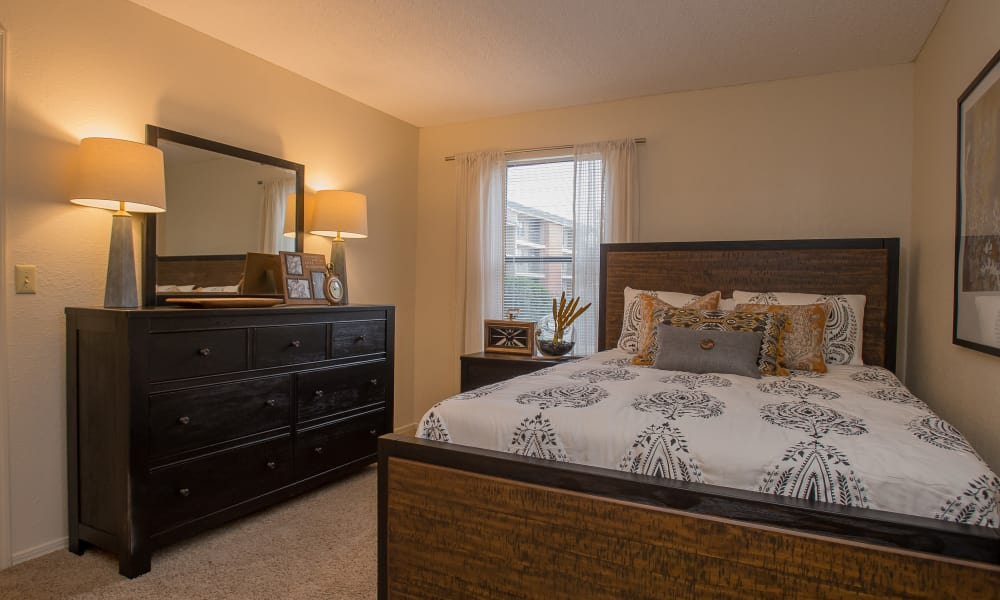Master bedroom at Woodscape Apartments in Oklahoma City, Oklahoma