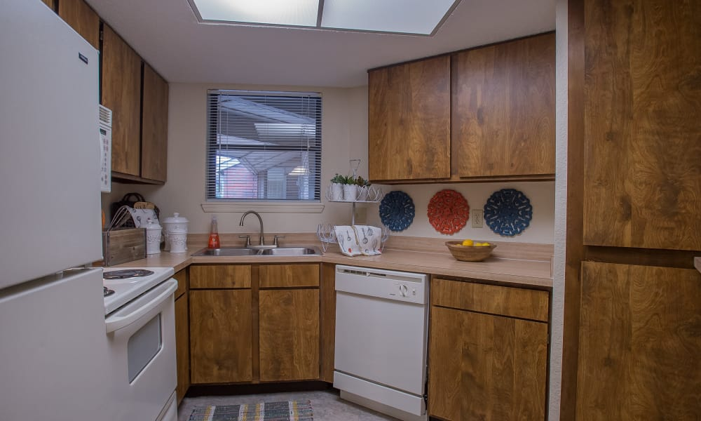 Kitchen with plenty of cabinet space at Woodscape Apartments in Oklahoma City, Oklahoma