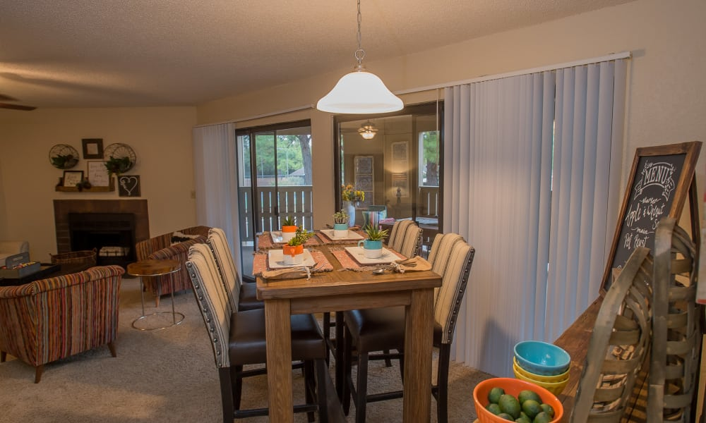 Bright dining room at Woodscape Apartments in Oklahoma City, Oklahoma