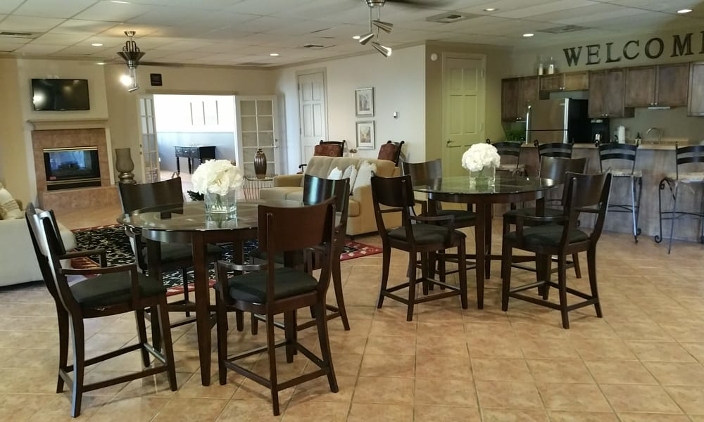 Dining area at Acacia Park Apartments' clubhouse in El Paso, Texas