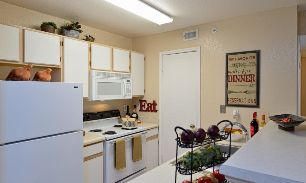 An apartment kitchen at Acacia Park Apartments in El Paso, Texas