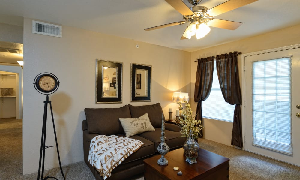 Living room with a ceiling fan at Acacia Park Apartments in El Paso, Texas