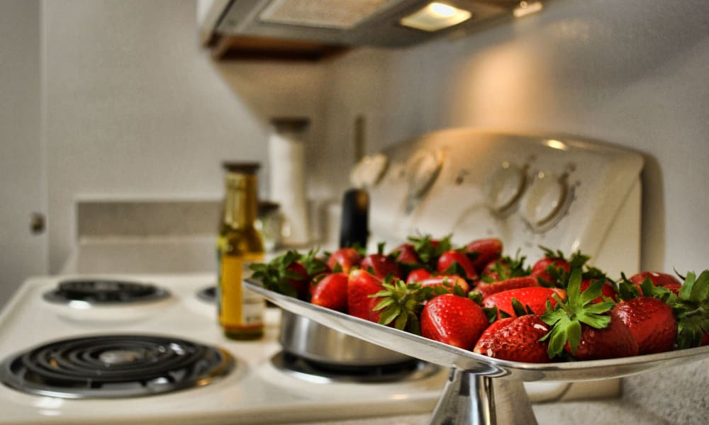 An apartment kitchen with fresh strawberries on display at Double Tree Apartments in El Paso, Texas