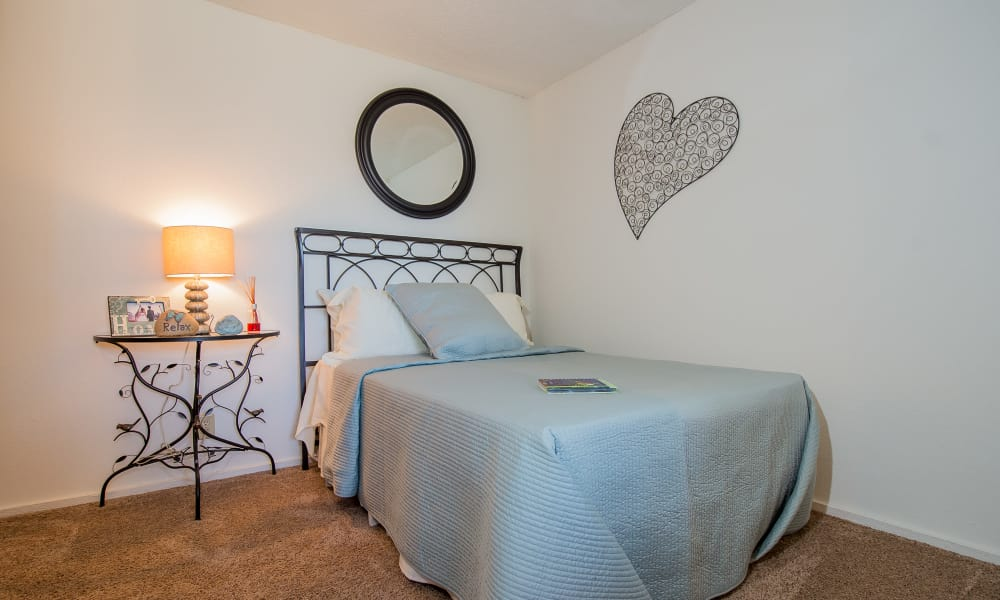 Carpeted bedroom at Fox Run Apartments in Wichita, Kansas