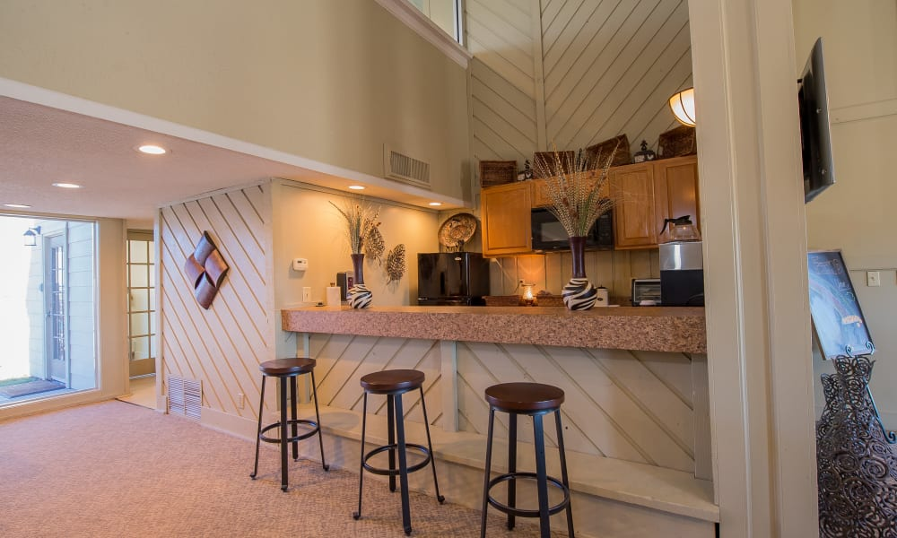 Bar seating at Fox Run Apartments' clubhouse in Wichita, Kansas