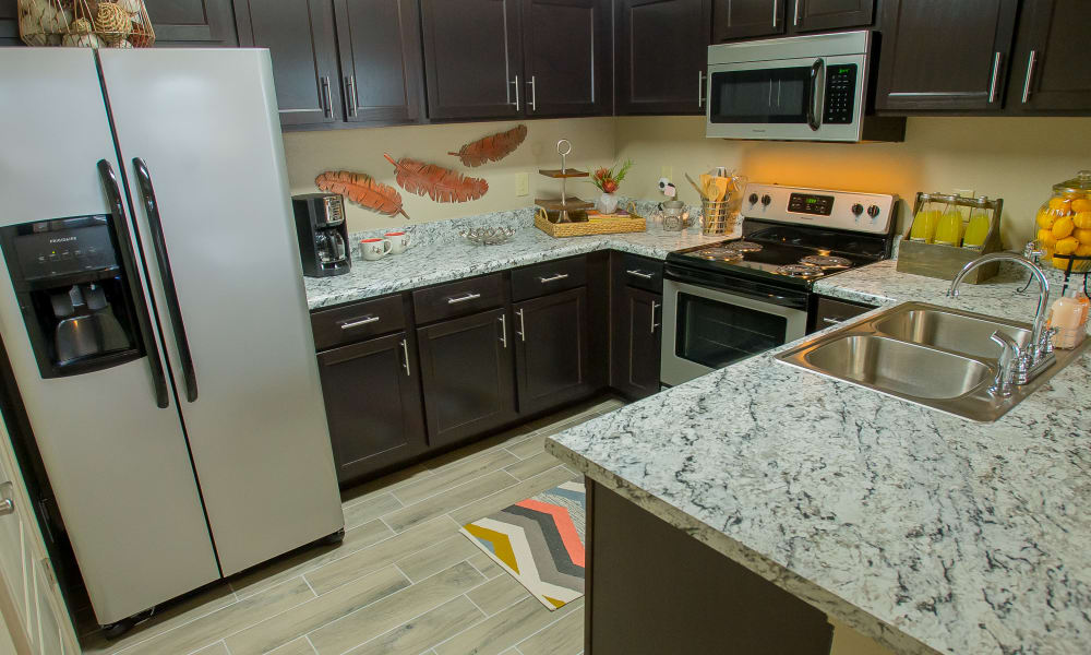 Kitchen with granite countertops at Icon at Corpus Christi in Corpus Christi, Texas