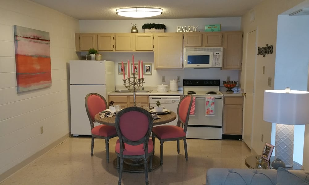 Kitchen and dining room at The Phoenix Apartments in El Paso, Texas