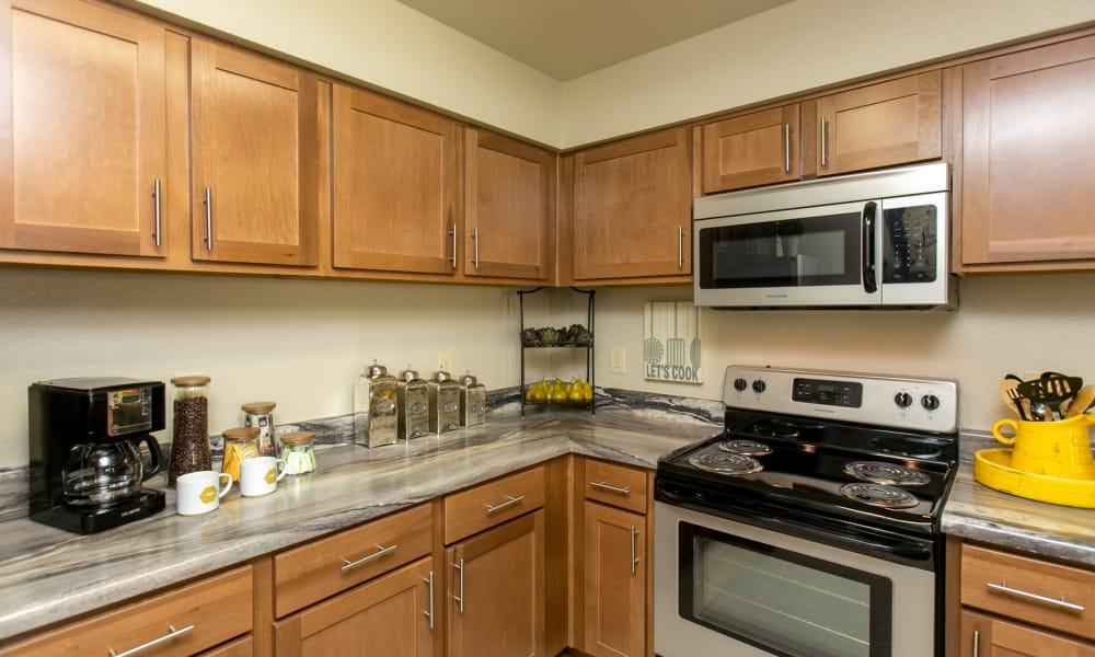 Kitchen with stainless steel appliances at Tuscana Bay Apartments in Corpus Christi, Texas