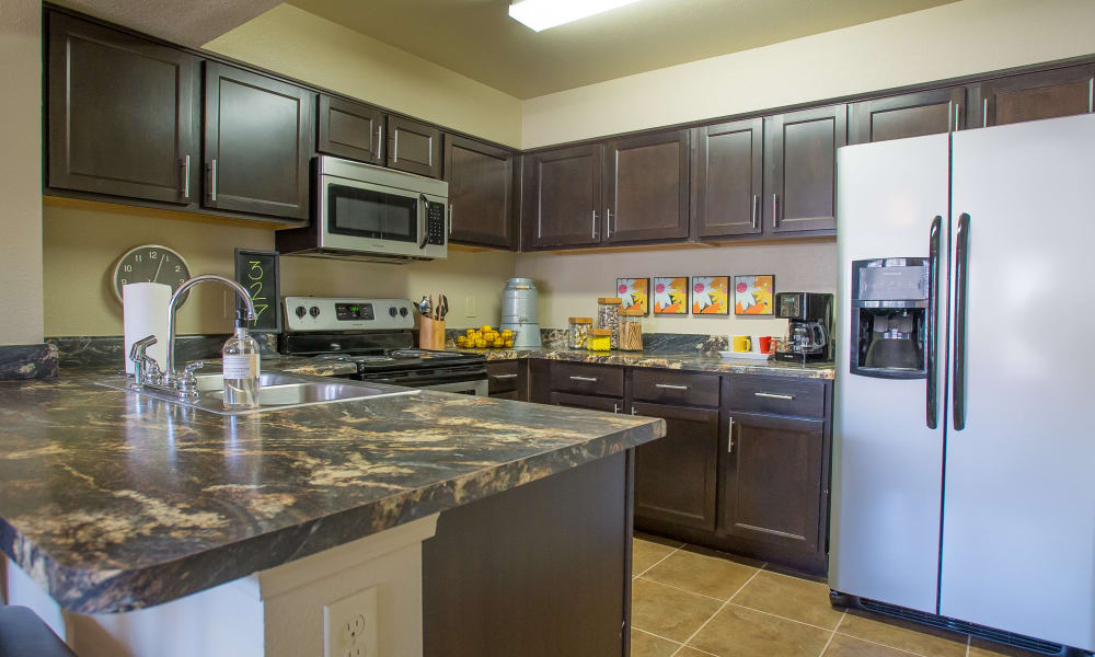 Kitchen at Mission Point Apartments in Moore, Oklahoma