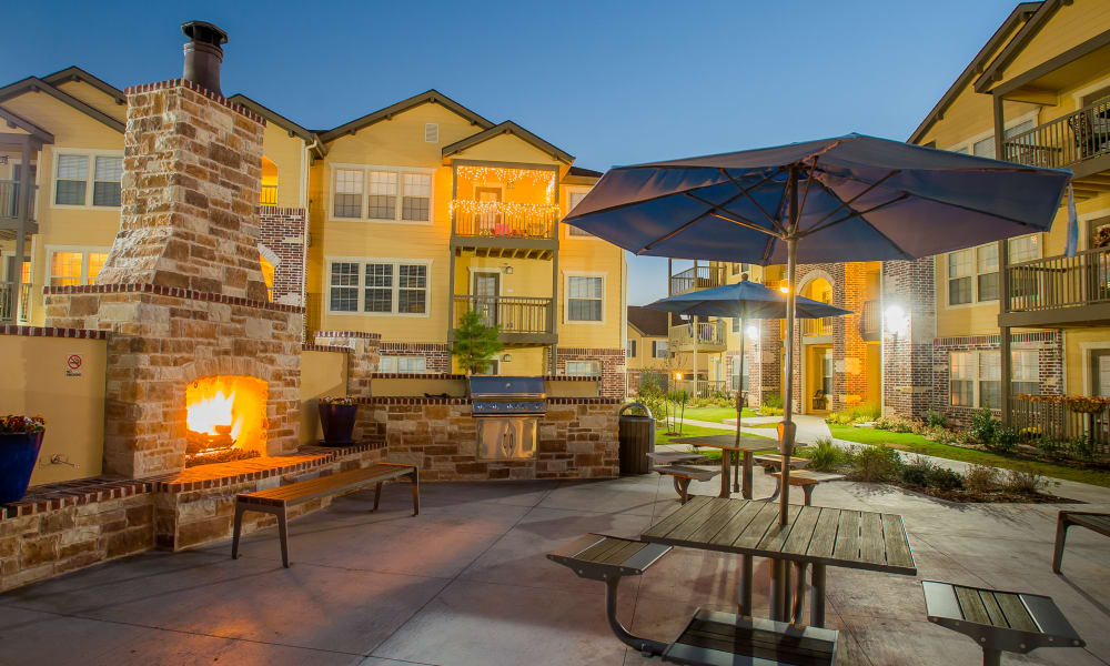 Outdoor patio with fireside seating at Mission Point Apartments in Moore, Oklahoma