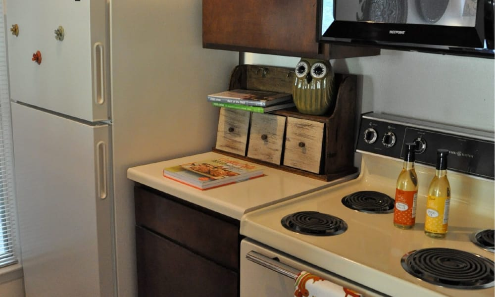 An apartment kitchen at The Chimneys Apartments in El Paso, Texas