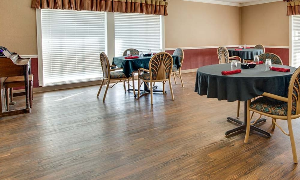 Open dining room with hardwood floors at Wheatland Nursing Center in Russell, Kansas