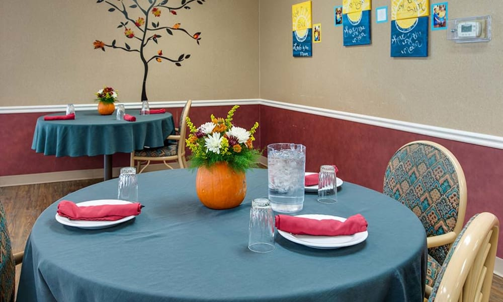 Blue dining table set for a meal at Wheatland Nursing Center in Russell, Kansas