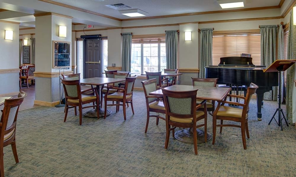 Main dining room with a piano at Waldron Place Senior Living in Hutchinson, Kansas