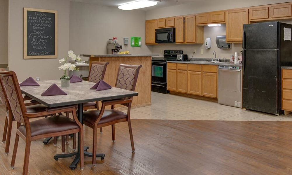 Community kitchen and dining room seating at St. Clair Nursing Center in Saint Clair, Missouri