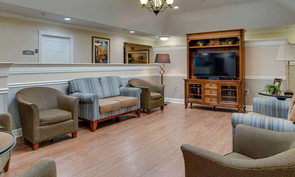 Entertainment room with comfortable seating at Parkwood Meadows Senior Living in Sainte Genevieve, Missouri