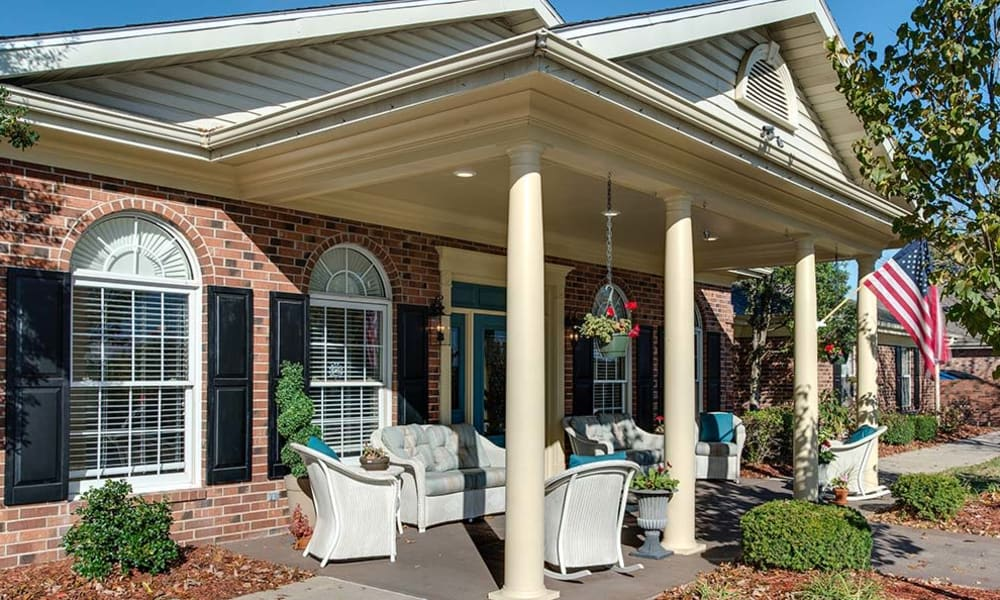 Back patio with seatnig at NorthPark Village Senior Living in Ozark, Missouri