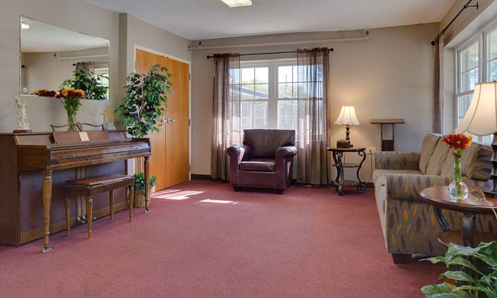 Community lounge with comfortable seating at Montgomery Place in Independence, Kansas